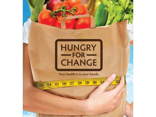 "A brown paper bag full of vegetables with the slogan: ""Hungry for change"""